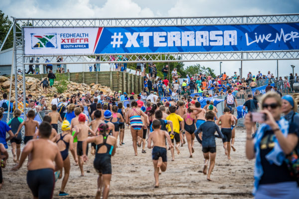 The Elgin-Grabouw Country Club was bustling with excitement on Friday, 23 February 2018 when 458 eager junior triathletes toed the line at the water's edge of the Eikenhof Dam ready to participate in the action of the much anticipated Fedhealth XTERRA Kids Race. Junior XTERRA Warriors in action on the day.  Photo Credit:  Tobias Ginsberg