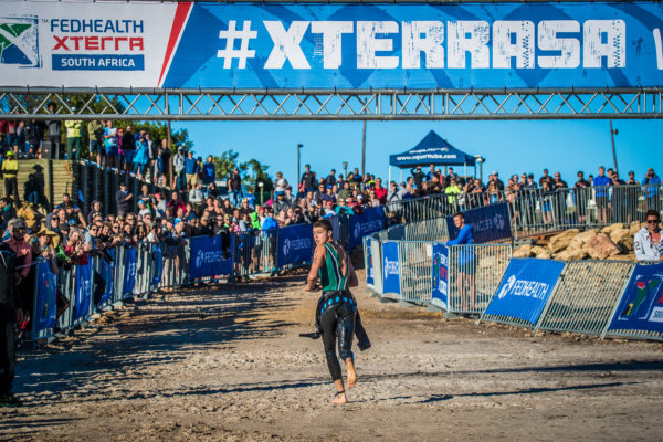 Jamie Riddle checking where the competition is after exiting the swim in a first place position at the 2018 Fedhealth XTERRA Lite at the Elgin Grabouw Country Club on Sunday, 25 February 2018.  Photo Credit:  Tobias Ginsberg