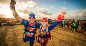 "Celebrating its 10th anniversary at the picturesque Boschendal Wine Estate (Stellenbosch/Franschhoek) the weekend of 27 – 29 April 2018, the AfricanX Trailrun presented by ASICS will treat trail runners to an exhilarating trail running experience.  Although all three stages of the AfricanX Trailrun are equally special, Stage Two features 'that extra flair' with trail runners allowing their creative sides to get the better of them as they try to outdo their rivals in the AfricanX's ""Best Dressed"" competition.  With awesome sponsor prizes up for grabs, ""Dress Up Day"" is sure to be the source of much excitement.  Seen here (from left to right):  Adnaan Mohamed and Sonja Britz of Team ""Superman and Superwoman"" in action during Stage Two ""Dress Up Day"" of the 2017 AfricanX Trailrun presented by ASICS.  Photo Credit:  Tobias Ginsberg"