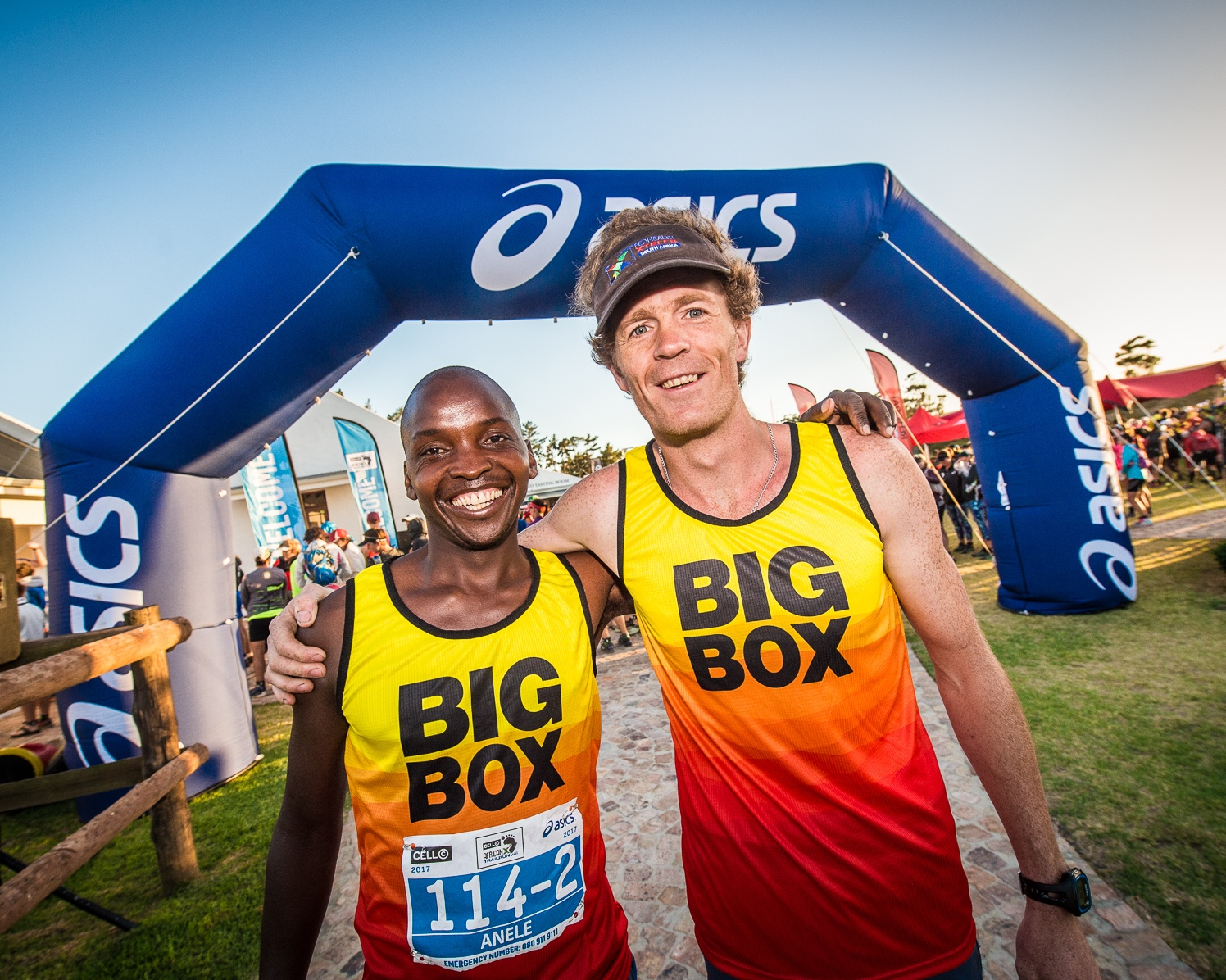 "Anele Mnukwa and Francois Groenewald of ""Team Big Box"" during the 2017 AfricanX Trailrun presented by ASICS.  Photo Credit:  Tobias Ginsberg"