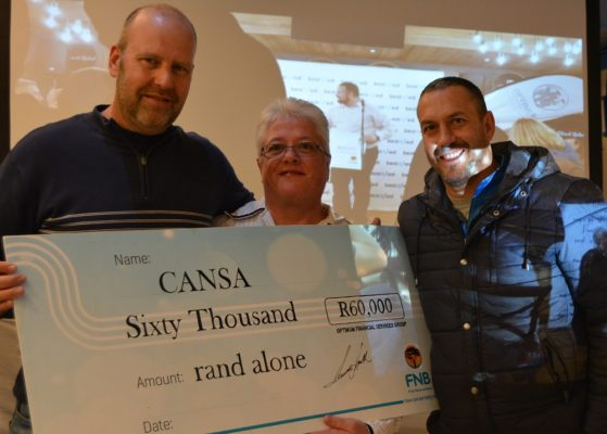Making their donation of R50 000 to Emmie Bonner of the Rustenburg Care Centre at last year's Bestmed Cycle4Cansa Championship are chief executive Louwrens Smith (left) and marketing director Werner Swanepoel (right). Photo: Full Stop Communications