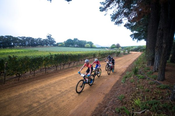 Mixed category competitors Matthew Stamatis (front) and Samantha Sanders (second) won the 49km opening stage of the Liberty Winelands Encounter, presented by STANLIB, from Zorgvliet Wine Estate to Le Franschhoek Hotel in the Cape Winelands today. Photo: Robert Ward