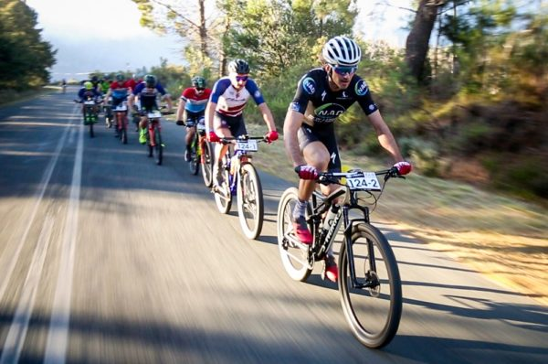 Matt Beers (front), followed by teammate HB Kruger, leads the men's team race on the 48km second stage of the Liberty Winelands Encounter mountain-bike race in Franschhoek in the Cape Winelands today. Picture: Rat Race Media