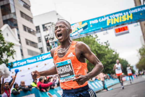 Morris Gachaga claiming victory at the 4th annual FNB Cape Town 12 ONERUN.  Photo Credit:  Tobias Ginsberg