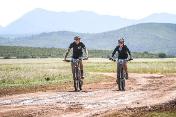 Oliver and Alana Munnik cruising the gravel roads of the opening stage of the 2018 BUCO Dr Evil Classic, side-by-side. Photo by Oakpics.com.