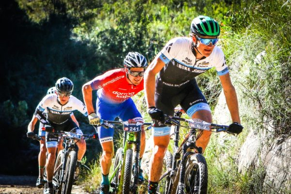 Paris Basson, on the wheel of young Aidan Connelly during Stage 2 of the BUCO Dr Evil Classic. Photo by Oakpics.com.