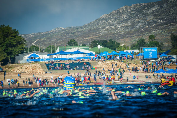 Swimmers in action at the 4th annual Sanlam Cape Mile brought to you by Sanlam Investments at the Eikenhof Dam (Elgin, Grabouw) in 2018.  Photo Credit:  Tobias Ginsberg