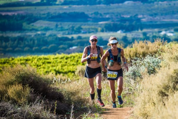 Chantel Nienaber and Katya Soggot in action during the 2018 AfricanX Trailrun in Stellenbosch.  Photo Credit:  Tobias Ginsberg