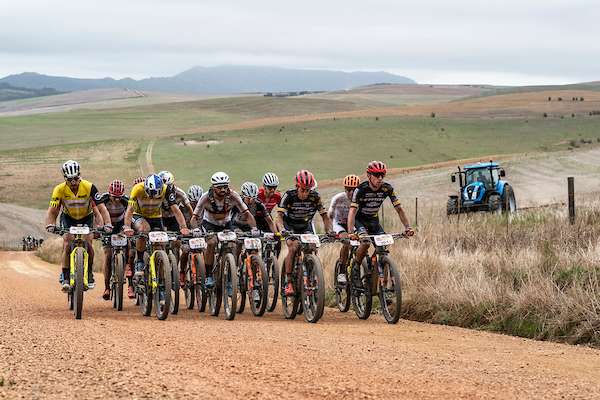 The leading bunch during stage 1 of the 2019 Absa Cape Epic Mountain Bike stage race held from Hermanus High School in Hermanus, South Africa on the 18th March 2019. Photo by Nick Muzik/Cape Epic PLEASE ENSURE THE APPROPRIATE CREDIT IS GIVEN TO THE PHOTOGRAPHER AND ABSA CAPE EPIC