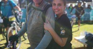 "Fifteen year old Jenna Schubach from Rustenburg will take on the 2019 FNB Platinum Trail Run as part of her ""Endometriosis Awareness"" campaign.  Schubach was diagnosed with endometriosis in 2017 at the age of 14.  When entering the FNB Platinum Trail Run online, trail runners can choose to make a donation towards Jenna's ""Endometriosis Awareness"" campaign.  Alternatively entrants can also show their support by wearing anything yellow on event day.  Seen here:  Jenna with her father Murray at the FNB Magalies Monster MTB Classic."