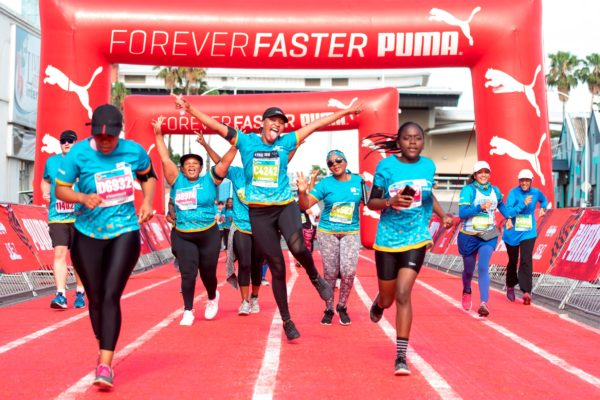 "Enthusiastic runners in action during the ""PUMA Beat Bolt Sprint"" section of the 2018 FNB Durban 10K CITYSURFRUN route.  Photo Credit:  Anthony Grote"
