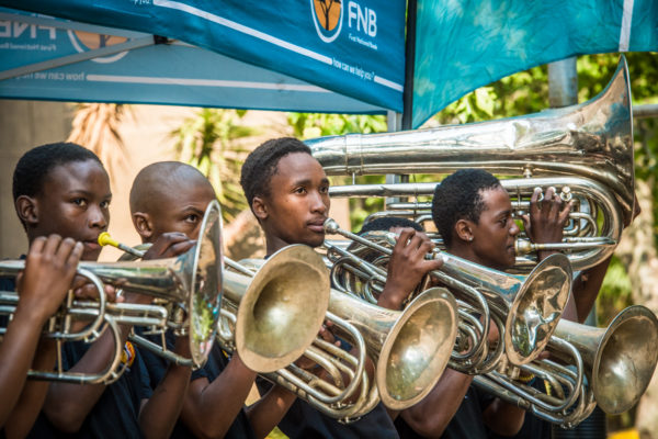 Field Band members add to the experience at the 2018 FNB Joburg 10K CITYRUN.  Photo Credit:  Tobias Ginsberg