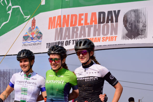 Last year's race winner Candice Lill is flanked by runner up Jeannie Dreyer (left) and third placed Tiffany Keep after the Mandela Day Marathon MTB Dash. Photo: Tim Whitfield  / Sports Wrighte