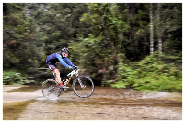The water crossings in the forests between the base of the Big Dipper and Check Point 5 were deeper than they had been the week before, forcing riders to get creative to keep their feet dry. Photo by Jacques Marais