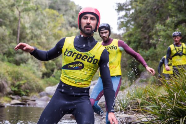 Logan Eales (left) and Teager Eales (right) racing down the Kaaiman's river in the Torpedo SwimRun WILD Image by Caleb Bjergfelt