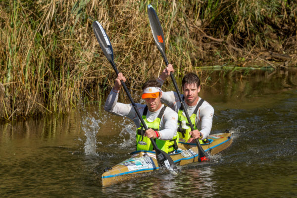 """Greg (front) and Ryan Low power away to win the final stage of the Breede River Canoe Marathon on Sunday. """"Because we raced the same section that we raced on the first day, everyone had learnt a few tricks so the racing was far harder and more tactical,"""" said Ryan Louw. Kassie Karstens/Gameplan Media"""