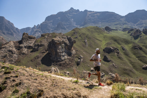 Elite race winner Kane Reilly descends from the Rhino Peak (in the background) at the 2019 Rhino Peak Challenge in the Southern Drakensberg on Saturday. Reilly broke his own FKT record for the 23km outing. Anthony Grote/ Gameplan Media