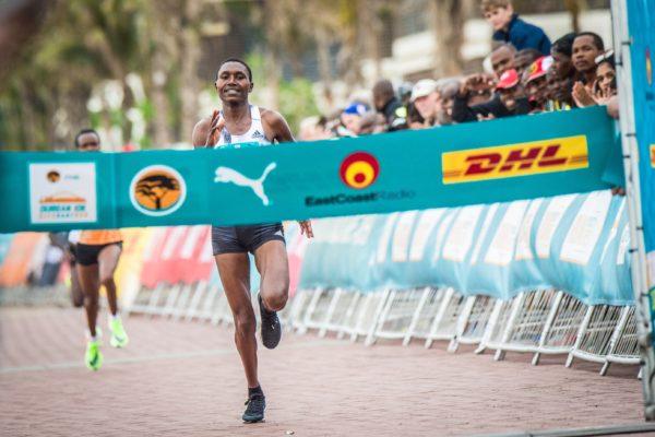 Evaline Chirchir, Sheila Chepkirui and Beatrice Mutai lead the women's race at the 2019 FNB Durban 10K CITYSURFRUN.  Photo Credit:  Tobias Ginsberg