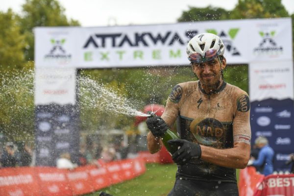 Matt Beers celebrates his Momentum Health Attakwas Extreme presented by Biogen title. Photo by ZC Marketing Consulting.